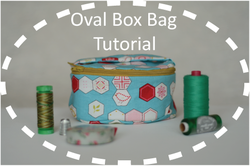 Oval box bag button